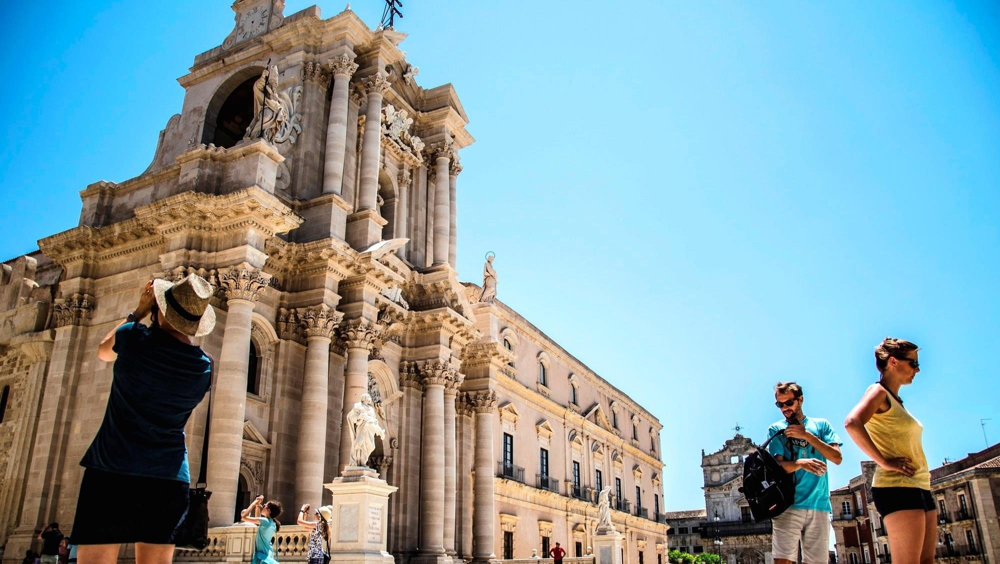 Cathedral of Siracusa in Sicily during a sunny day with tourists taking pictures